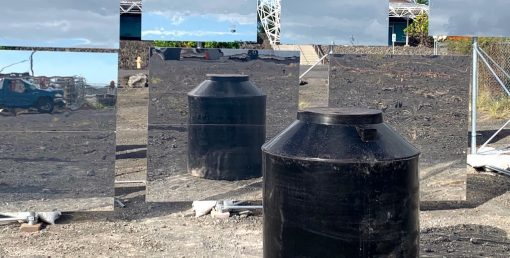 A sustainably-molded water tanks, reflected in heliostats.